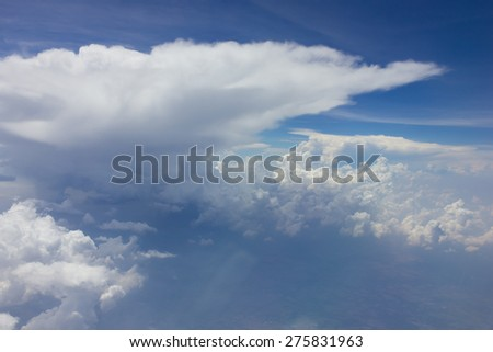 Clouds in the sky out side airplane - stock photo