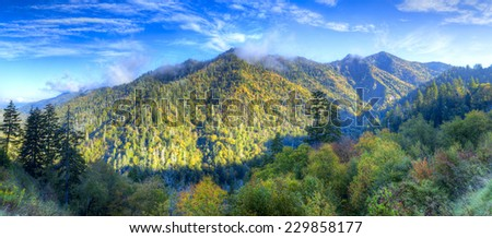 Clouds lingering on top of the Smokies. - stock photo
