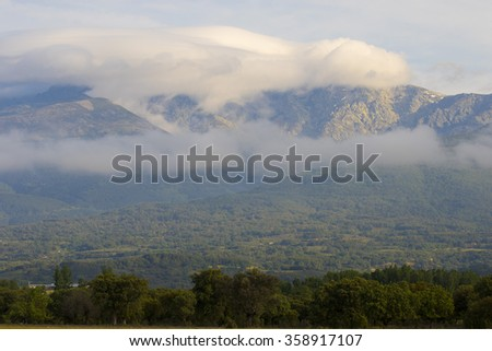 Clouds ocer Gredo`s mountain - stock photo