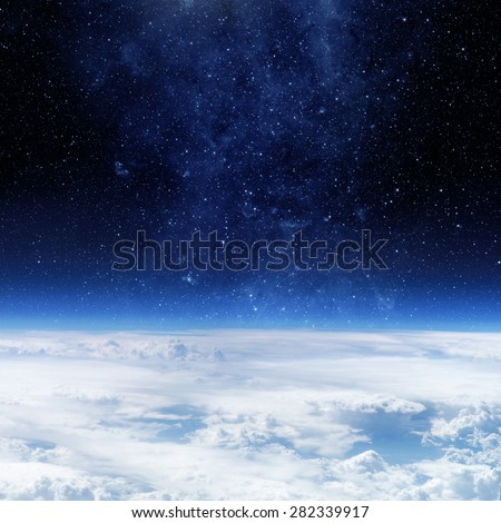 Clouds of Earth planet and star sky on the background. Elements of this image are furnished by NASA - stock photo