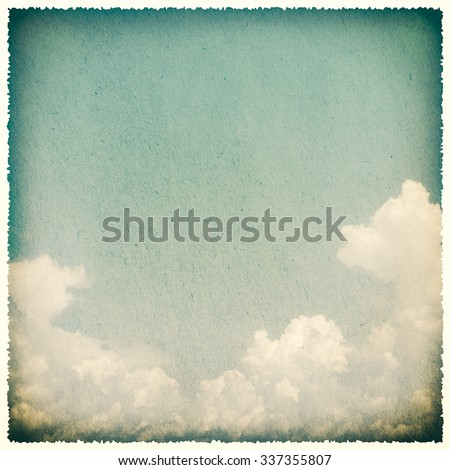 Clouds on a textured, vintage paper background with grunge stain - stock photo