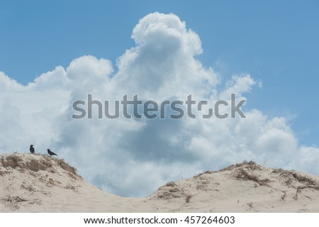 Clouds on the top of the sand hill  - stock photo