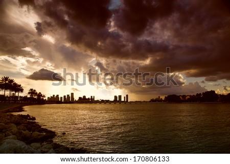 Clouds over a city at dusk, MacArthur Causeway Bridge, Miami, Florida, USA - stock photo