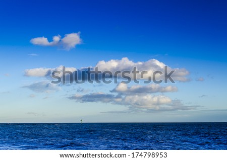 Clouds over a offshore wind farm UK - stock photo