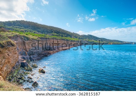 clouds over Castelsardo shore, Sardinia - stock photo