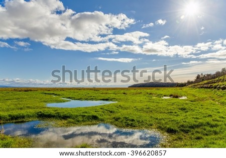 Clouds over fields, Grange-over-sands, Cumbria, England  - stock photo