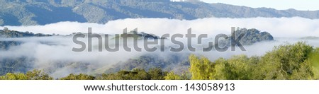 Clouds over green spring hills of Southern California, Ventura County, Oak View, CA - stock photo