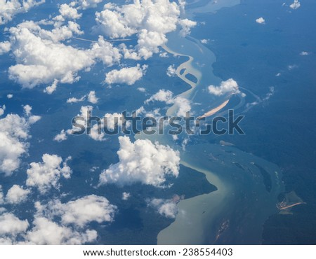 Clouds over of amazon forest and river, Aerial view  - stock photo