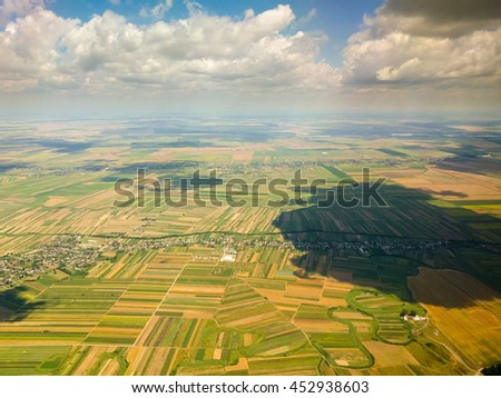Clouds over the meadow - stock photo
