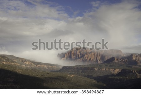 Clouds rolling over Kolob fingers as seen from Smith's Mesa - stock photo