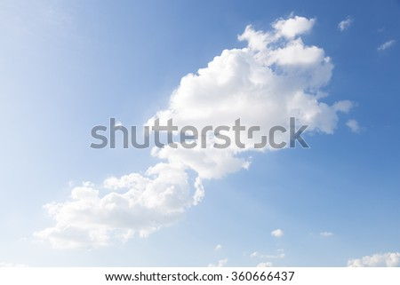 Clouds scattered across the sky. The clouds dispersed in a bright clear day. - stock photo