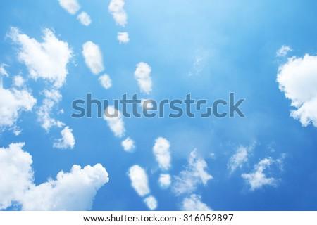 Clouds shaped like shoes print. - stock photo