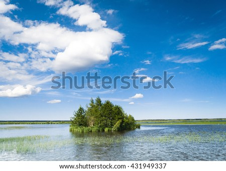 Cloudscape Above Green Island  - stock photo