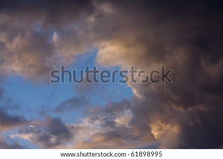 Cloudscape Image of a Brewing Storm in early Evening. - stock photo