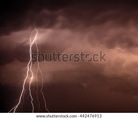Cloudscape with lightning bolt hitting among the clouds - stock photo