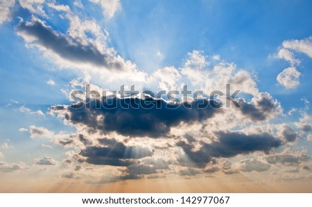 Cloudscape with ray of light - stock photo