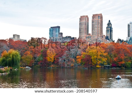 Cloudy autumn day at The Lake in Central Park, New York, New York. - stock photo
