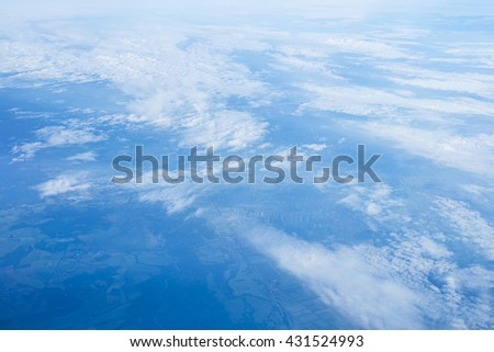 cloudy blue sky in Europe on morning sun light from window of airplane, determine to transport ion airline vacation for spring summer holiday. - stock photo