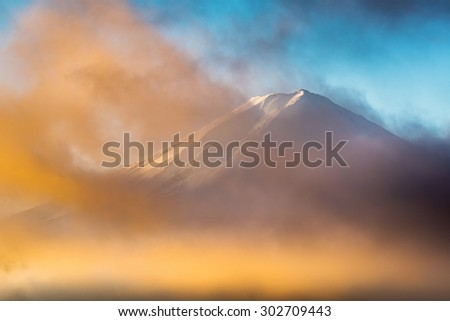 Cloudy conceal Fuji mountain in morning - stock photo