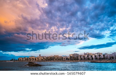 Cloudy landscape over Mola di Bari, south of Italy - stock photo