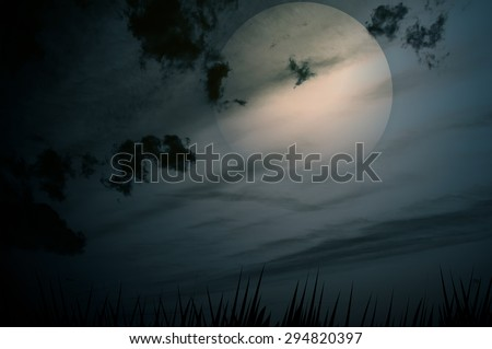 cloudy night sky with bright full moon - stock photo