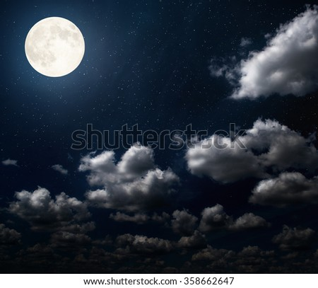 cloudy night sky with moon and star. Elements of this image furnished by NASA. - stock photo