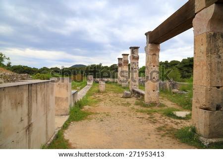 Cloudy sky above ancient sanctuary of Asclepius (Greek god of medicine) at Epidaurus, Greece - stock photo