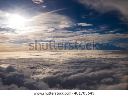 Cloudy sky on a plane - stock photo