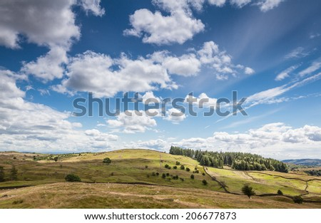 Cloudy sky over English countryside in Cumbria, UK.  - stock photo
