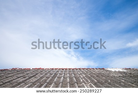 Cloudy sky over the asbestos roof tiles able to use as background - stock photo