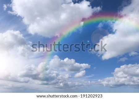 Cloudy sky with rainbow and bright sky - stock photo
