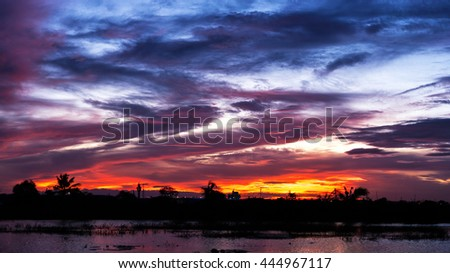 Cloudy stormy dramatic sky background, Dark ominous grey and red storm clouds, Abstract dark background, Sky like scattered bombs, Beautiful colorful sunset with silhouettes natural background - stock photo