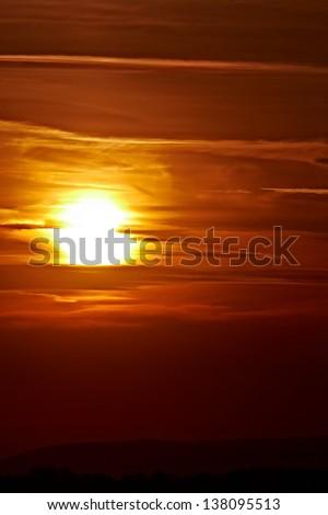 Cloudy sunset - stock photo