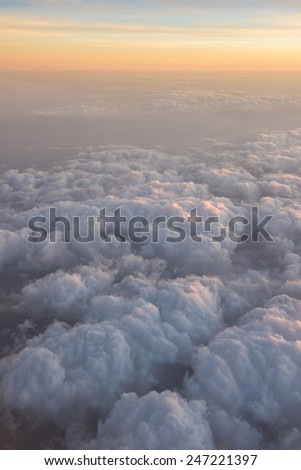 cloudy sunset sky shot from the plane on board - stock photo