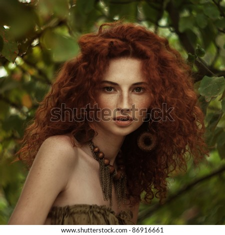 Clouse-up portrait of attractive beautiful red-haired woman; grain and texture added - stock photo