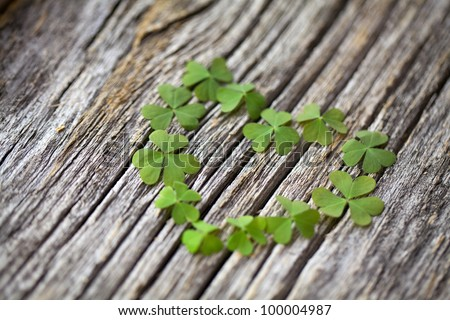 clover heart on wooden background - stock photo