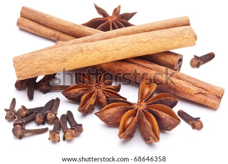 Cloves, anise and cinnamon isolated on white background. - stock photo