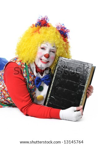 Clown holding large black book - stock photo