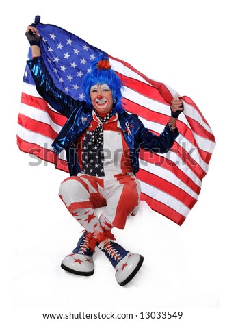 Clown holfing American flag - stock photo