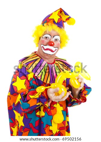Clown is disgusted as balloon dog uses the toilet in this hand.  Humorous photo isolated on white. - stock photo