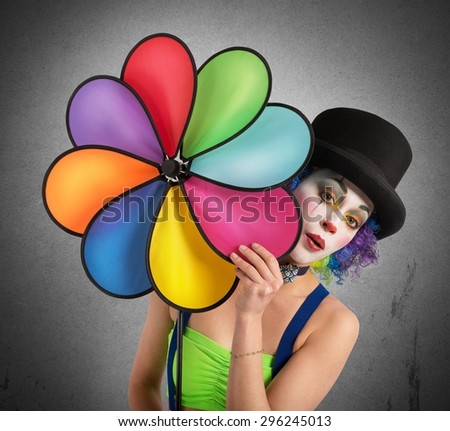 Clown posing with a helix toy colored - stock photo