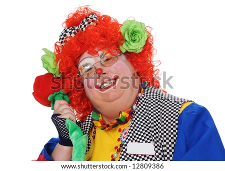 Clown posing with rose isolated over a white background - stock photo