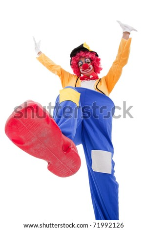 clown smashing something with his foot (isolated on white) - stock photo