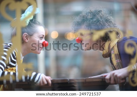 Clowns facing each other; street theater concept - stock photo