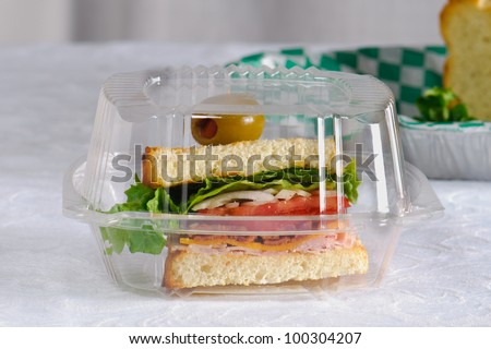 Club House Sandwich in a plastic take out container - stock photo
