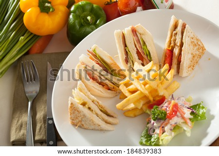 club sandwich, decorated club sandwich side with fried potato and salad - stock photo