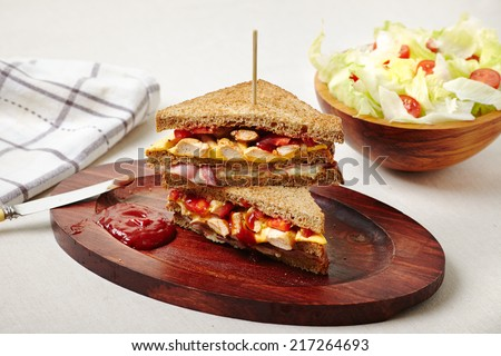 Club sandwich with salad - stock photo