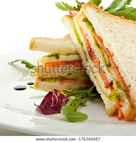 Club Sandwich with Salmon and Vegetables - stock photo