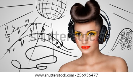 Clubbing fashionable girl at the nightclub with big vintage headphones on grey sketchy background of a disco ball and flowing music notes. - stock photo
