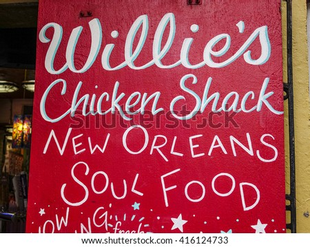Clubs and restaurants in New Orleans Bourbon Street French Quarter - NEW ORLEANS, LOUISIANA - APRIL 18, 2016  - stock photo